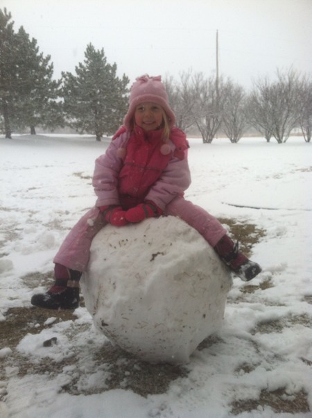 Vivi on her giant snowman base